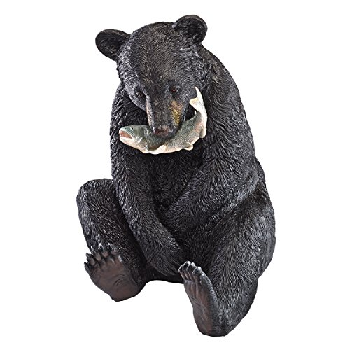 Cute Sitting Black Bear Eating Fish Statue